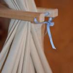 Holzstab der selbst genähten Federwiege